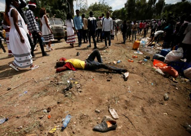 An injured protester waits for help after several people died during the Irrechaa, the thanks giving festival of the Oromo people in Bishoftu town of Oromia region, Ethiopia, October 2, 2016. REUTERS/Tiksa Negeri
